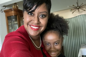 Photo of Tia Leathers, the Executive Director of Family and Community Engagement, and her daughter Taige.
