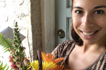 Photo of West Riverside Elementary teacher Gabriella Solano holding a flower bouqet